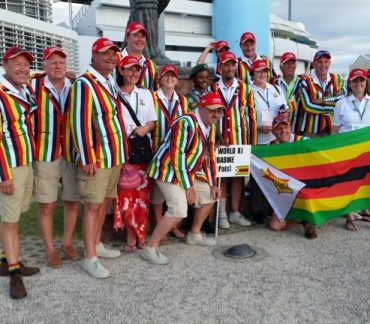 Team photo in striped blazers