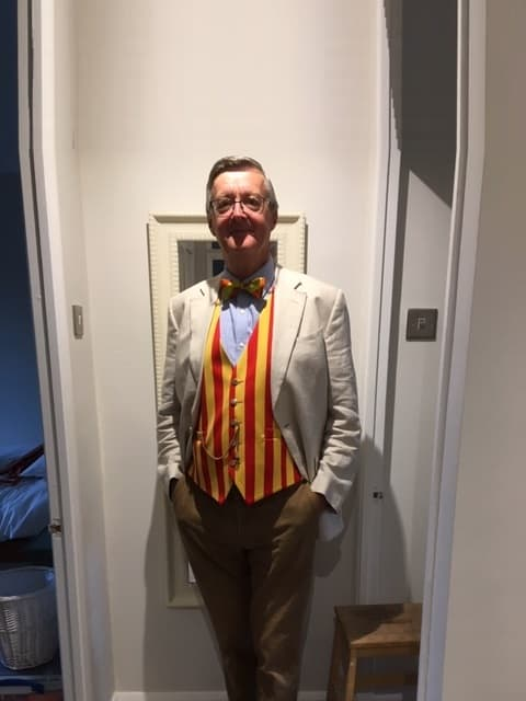 Man in red and yellow striped waistcoat