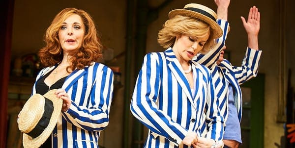 Ladies in Blue and White striped blazers