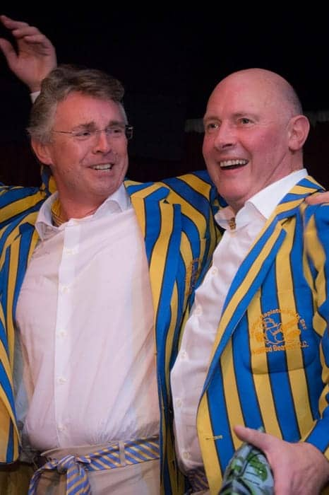 Men in yellow and blue striped blazers