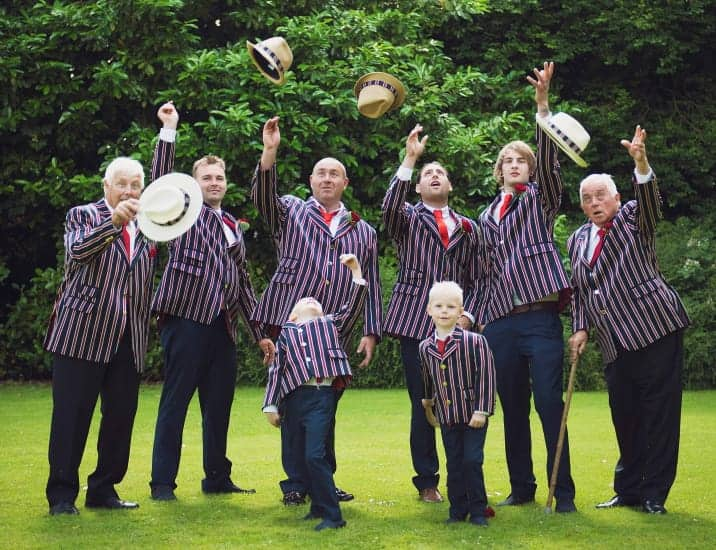 Group photo in striped blazers