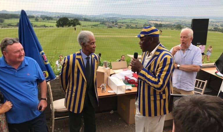 Gentlemen in blue and yellow striped blazer