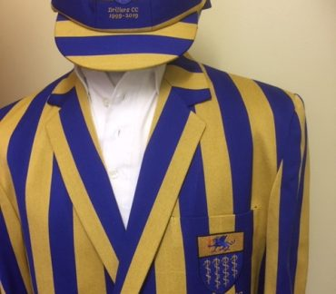 Blue and yellow striped blazer and cap