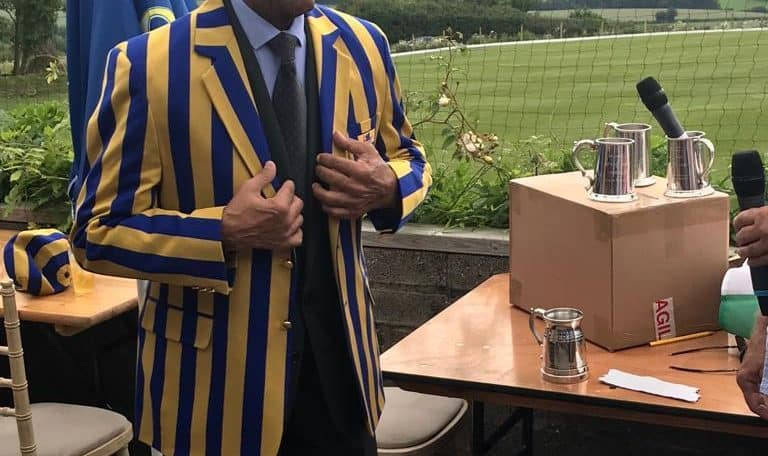 Gentleman in blue and yellow striped blazer