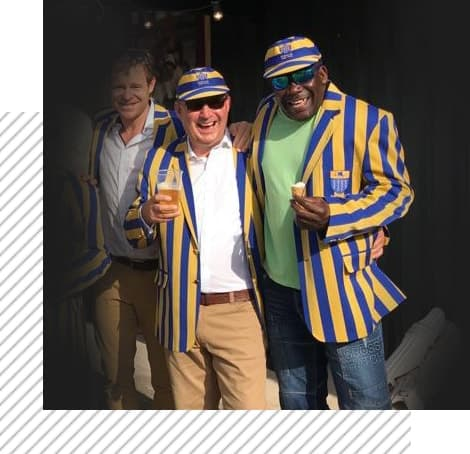 Men in blue and yellow striped blazers